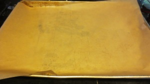 Line a cookie sheet with parchment paper.